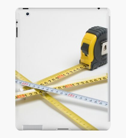 4 yellow and one unique white measuring tape on white background iPad Case/Skin