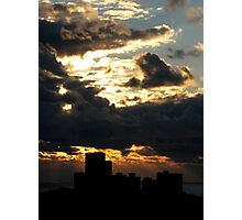 Dramatic sunset above buildings over sea Photographic Print