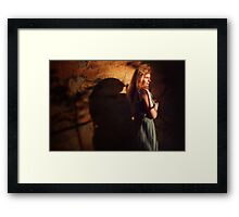 Creative portrait of young woman near wall Framed Print