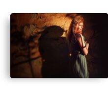 Creative portrait of young woman near wall Canvas Print