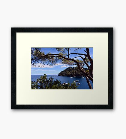 Natural landscape with boats in the water in Portofino, Italy. Framed Print