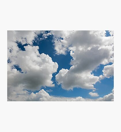 raised clouds on a blue sky Photographic Print