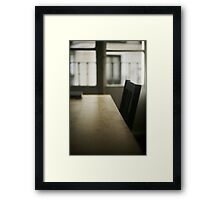 Wooden table desk and chair in empty room with window behind in beige brown colors artistic color digital photograph Framed Print