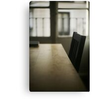 Wooden table desk and chair in empty room with window behind in beige brown colors artistic color digital photograph Canvas Print