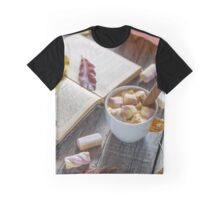 Hot chocolate with marshmallows in a  cup and book on  wooden surface.  Graphic T-Shirt