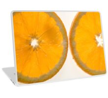 Cutout of a back lit slices of orange on white background Laptop Skin