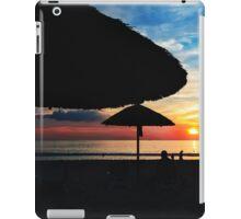 Sunset at the beach with sun umbrellas iPad Case/Skin
