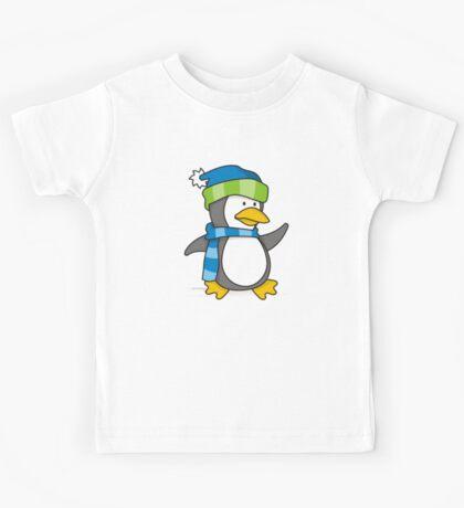 Little penguin walking on snow Kids Tee