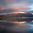 Sunset over the white summit of Skiddaw in the English Lake District by Martin Lawrence