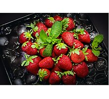 Ripe strawberry on ice with mint leaf Photographic Print