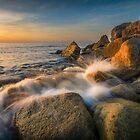 Sunrise, rocks and waves at Cala del Morro Blanc by Ralph Goldsmith