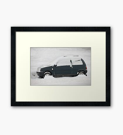 small car covered with snow Framed Print
