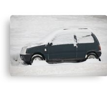 small car covered with snow Canvas Print