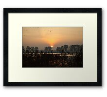Sunrise at a lake with flying birds. Framed Print