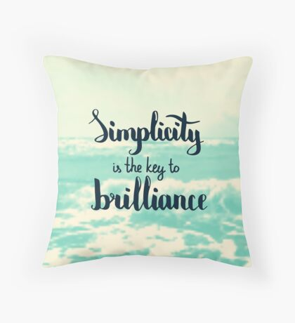 Simplicity is the key to brilliance.  Text on sea photo blur background. Throw Pillow