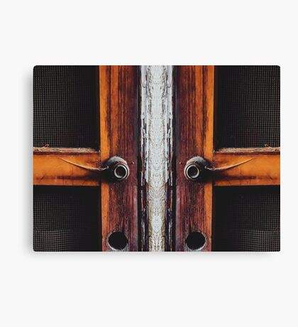 two old brown wooden doors Canvas Print
