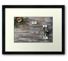 Christmas table place setting with christmas tree branches spoon knife fork and ribbon over wooden table with copy space Framed Print