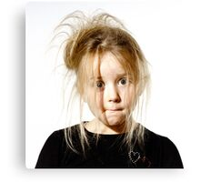 Disheveled preschooler girl with stupid face, isolated on white background Canvas Print