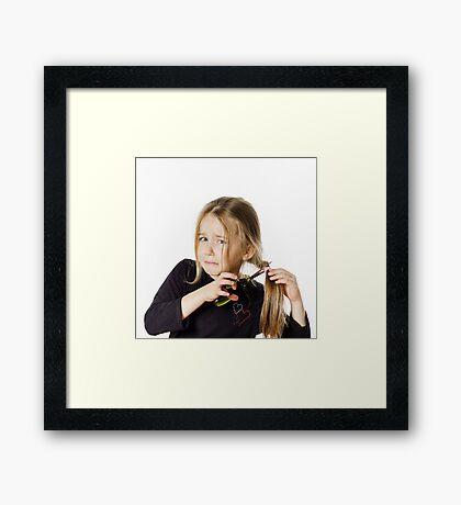 Cute little girl with scissors. Self hairdresser, isolated on white background Framed Print