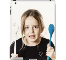 Preschooler girl playing with spoons for salad, isolated on white background iPad Case/Skin