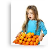 Cute little girl with full tray of mandarins, isolated on white background Canvas Print