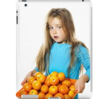 Cute little girl with full tray of mandarins, isolated on white background iPad Case/Skin