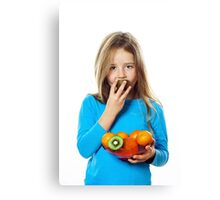 Cute little girl with plate of fruits: kiwi, date plum, mandarins, etc., isolated on white background Canvas Print