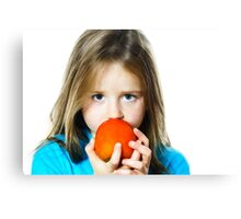 Little girl eating date plum, closeup view, isolated on white background Canvas Print
