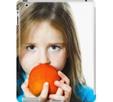 Little girl eating date plum, closeup view, isolated on white background iPad Case/Skin