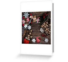 Christmas decoration hanging over the wooden background Greeting Card