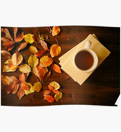 Cup of tea, books and autumnal foliage Poster