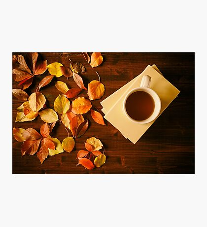 Cup of tea, books and autumnal foliage Photographic Print