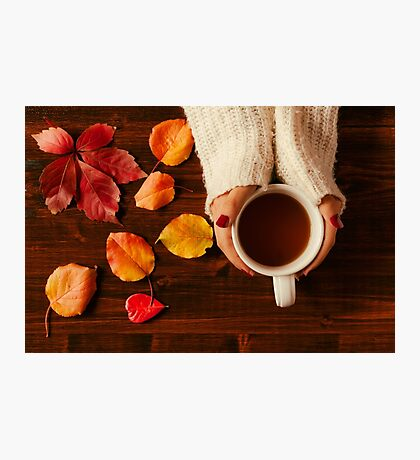 Woman hands holding teacup seen from above Photographic Print