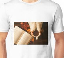 Woman hands holding teacup and opened book seen from above Unisex T-Shirt
