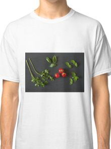 Green vegetables around three red tomatoes Classic T-Shirt