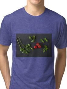 Green vegetables around three red tomatoes Tri-blend T-Shirt