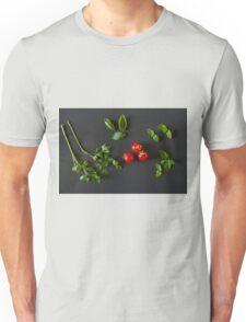 Green vegetables around three red tomatoes Unisex T-Shirt