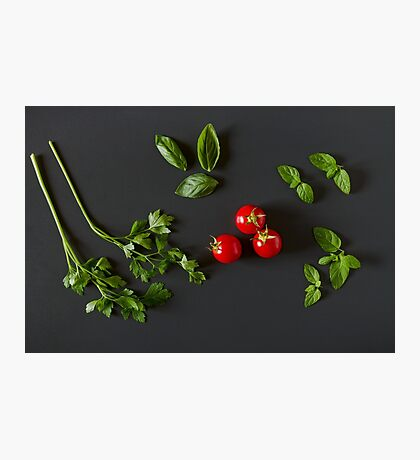 Green vegetables around three red tomatoes Photographic Print