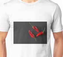 Red hot chili peppers over a dark background Unisex T-Shirt