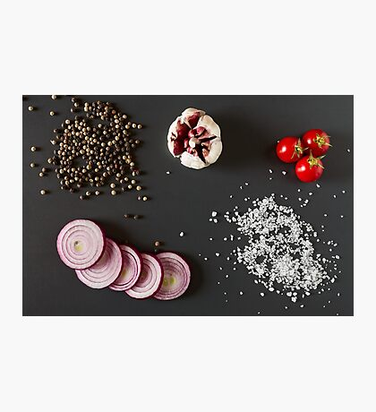 Vegetables, salt and pepper over a dark background Photographic Print
