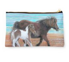 A trot on the beach Studio Pouch