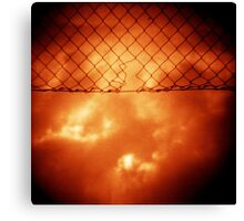 Wire mesh fence against stormy sky silver gelatin black and white medium format 120 6x6 negative analog film photo in sepia tones Canvas Print