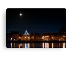 Building night lights and water reflection and moon Canvas Print