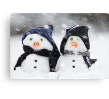 wo cute little snowman dressed for winter Canvas Print
