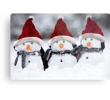 Snowmen with Christmas hats Metal Print
