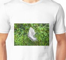 White goose feather on green grass Unisex T-Shirt