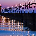 South Haven Lighthouse after Sundown with Reflections by Kenneth Keifer