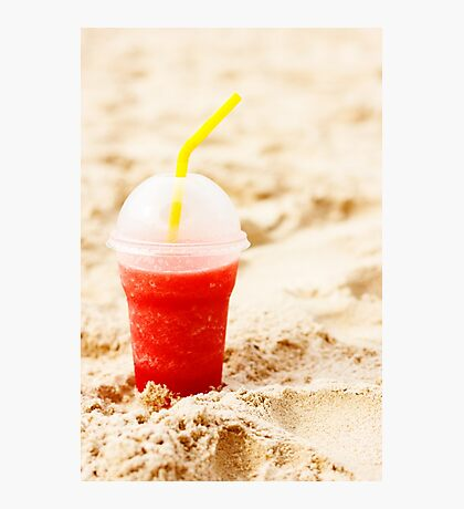 Red fruit icy cocktail in beach sand Photographic Print