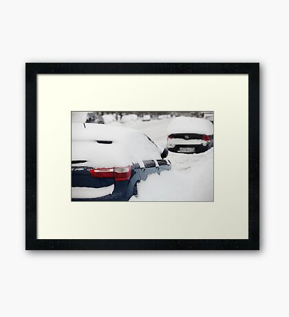 car covered with snow Framed Print