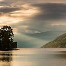 Searchlight hits Drummond Hill, Loch Tay, Perthshire, Scotland by Cliff Williams